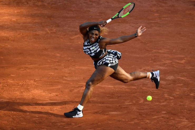 Serena Williams of the US returns the ball to Sofia Kenin of the US during their women's singles third round match on day seven of The Roland Garros 2019 French Open tennis tournament in Paris on June 1, 2019. AFP