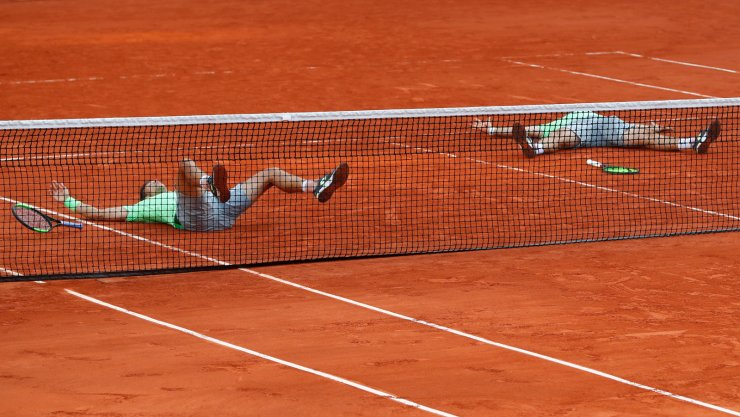 Germany's Kevin Krawietz, right, and Andreas Mies, left, celebrate winning the men's doubles final match of the French Open tennis tournament against France's Jeremy Chardy and Fabrice Martin at the Roland Garros stadium in Paris, Saturday, June 8, 2019. AP