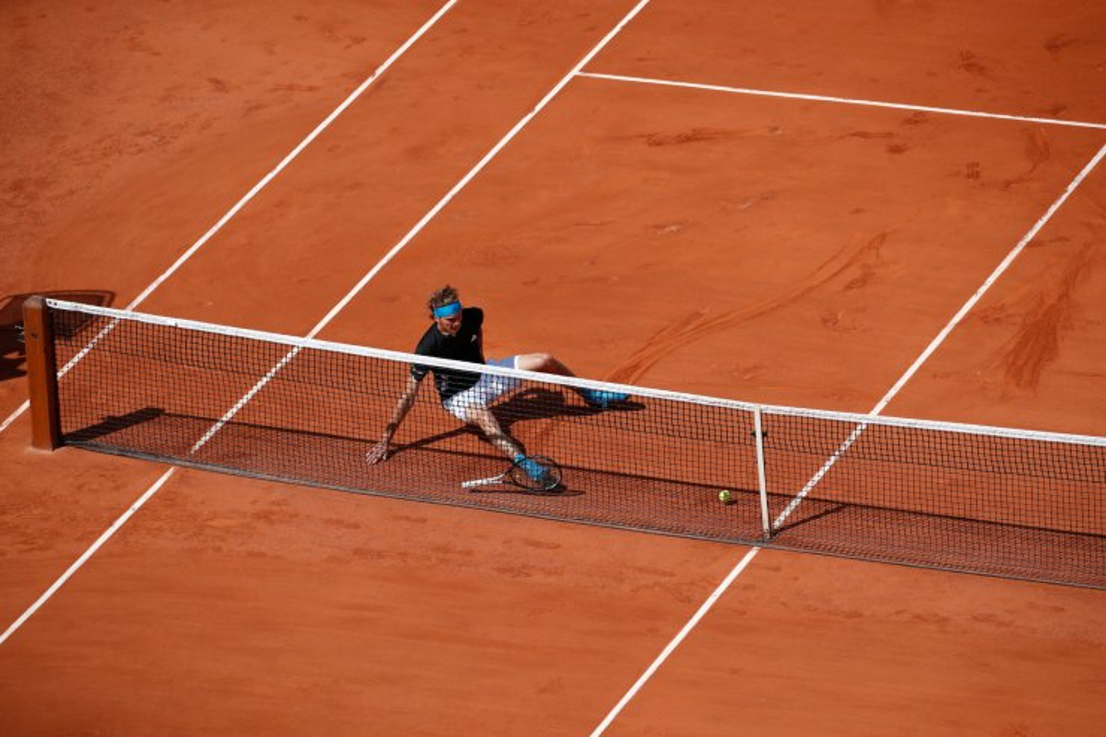 Germany's Alexander Zverev slips and falls as he runs to return Serbia's Novak Djokovic's drop shot during their quarterfinal match of the French Open tennis tournament at the Roland Garros stadium in Paris, Thursday, June 6, 2019. AP