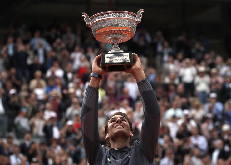 Rafael Nadal of Spain poses with the trophy after winning the men's final match against Dominic Thiem of Austria during the French Open tennis tournament at Roland Garros in Paris, France, 09 June 2019.  EPA