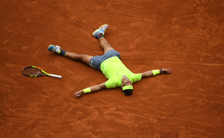 Spain's Rafael Nadal celebrates after winning against Austria's Dominic Thiem during their men's singles final match, on day fifteen of The Roland Garros 2019 French Open tennis tournament in Paris on June 9, 2019. AFP