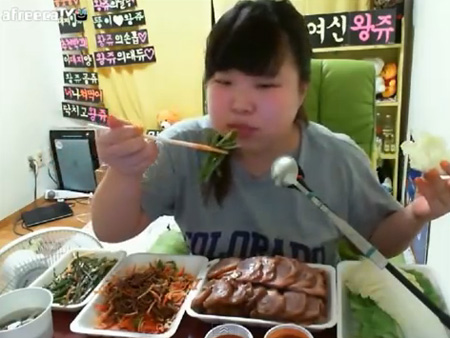 A 'mukbang' VJ on online video platform afreecaTV with her foods / Screen capture from YouTube