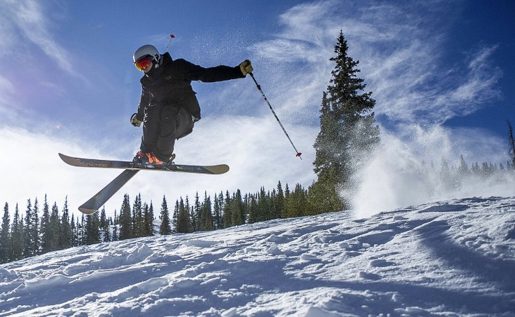 Bear Bolduc gets skis down Snowmass Mountain in Colorado, Friday, Nov. 23, 2018. Snowmass Ski Area, Crested Butte Mountain Resort and Telluride Ski Resort all opened for the season Thursday. AP