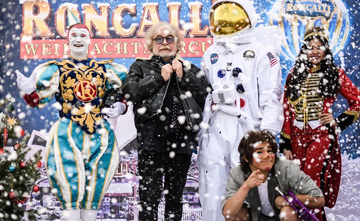 Founding director of Roncalli Circus, Bernhard Paul (C) poses with members of his ensemble white clown Gensi (L) and clown Chistirrin (down-R) in artificial snow during a photocall for the Roncalli Christmas Circus at the Tempodrom event location in Berlin, Germany, 14 November 2018. EPA