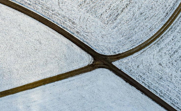 An aerial view shows snow covered fields in Simbach, southern Germany, on November 29, 2018. AFP