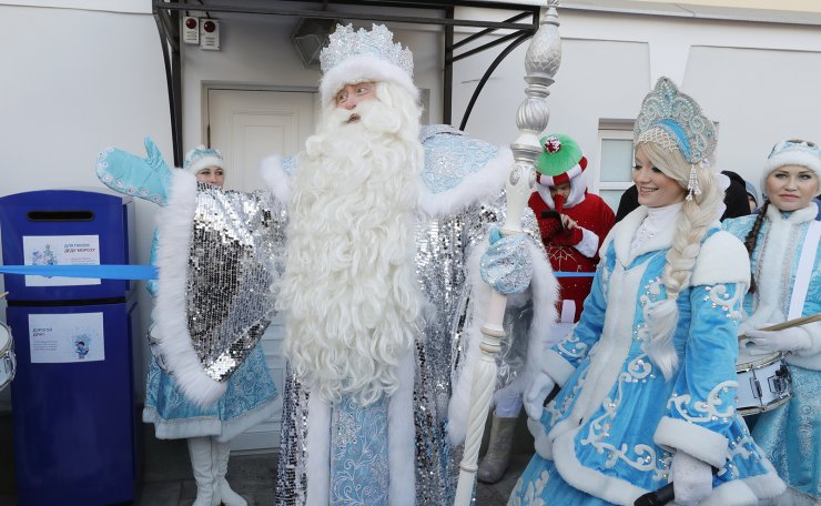 Performers dressed up as Ded Moroz (Father Frost) and Snegurochka (Snow maiden) during a ceremony as a post box is installed for those who wish to send a letter to Father Frost, at the Moscow Zoo, in the run-up to Christmas and New Year's Eve celebration. TASS