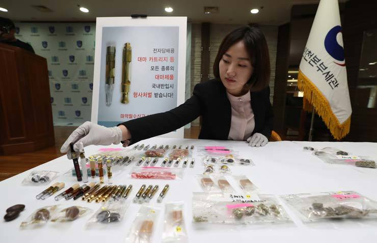 Marijuana products including edibles and an e-cigarette cartridge in the customs office at Incheon International Airport. Illegal drugs have become more accessible to people here. / Yonhap