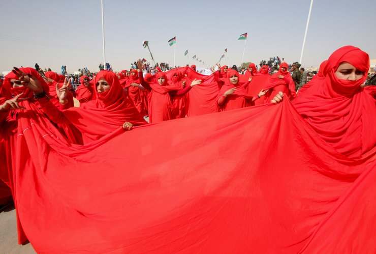 Sahrawi women take part in a parade at the Awserd refugee camp in Tindouf, Algeria February 27, 2021. Picture taken February 27, 2021. REUTER