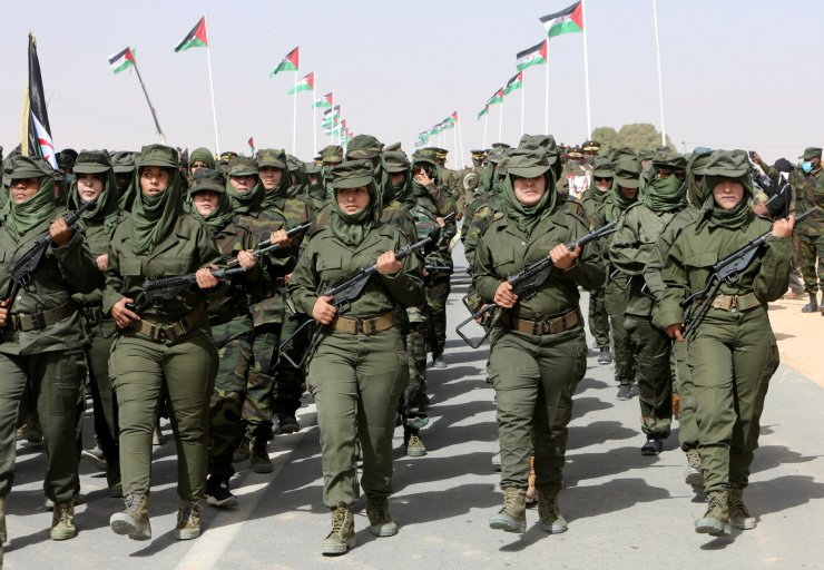 Sahrawi women soldiers carry their weapons and they parade at the Awserd refugee camp in Tindouf, Algeria February 27, 2021. Picture taken February 27, 2021. REUTERS