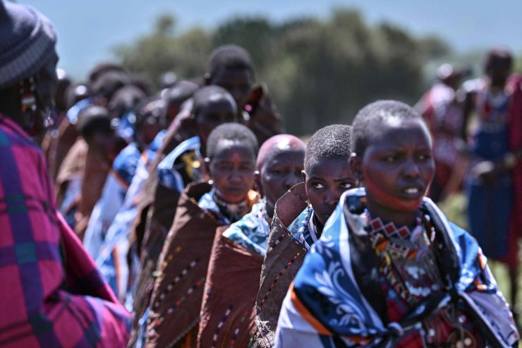 Women from the Kenyan Maasai tribe participate alongside their husbands in a rite of passage to mark the transition of an age-set  to cultural junior elder from Moran (Maasai for warrior age-set), at a manyatta or traditional homestead built specifically for the ceremony, near Lemek town, within the Masai-Mara National Reserve ecosystem, in Narok county, on February 27, 2021. AFP