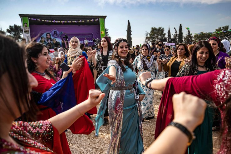 Kurdish Syrian women take part in Women's Day celebration in the Syria's northeastern city of Qamishli on March 6, 2021. AFP