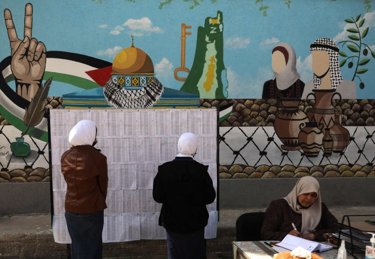 Palestinian women looks for their names on the electoral roll at a school in Gaza City on March 3, 2021, ahead of the first Palestinian elections in 15 years. AFP
