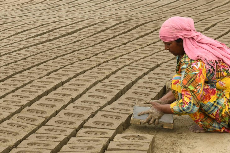 A labourer works at a brick kiln on the outskirts of Amritsar on March 7, 2021, on the eve of the International Women's Day. AFP