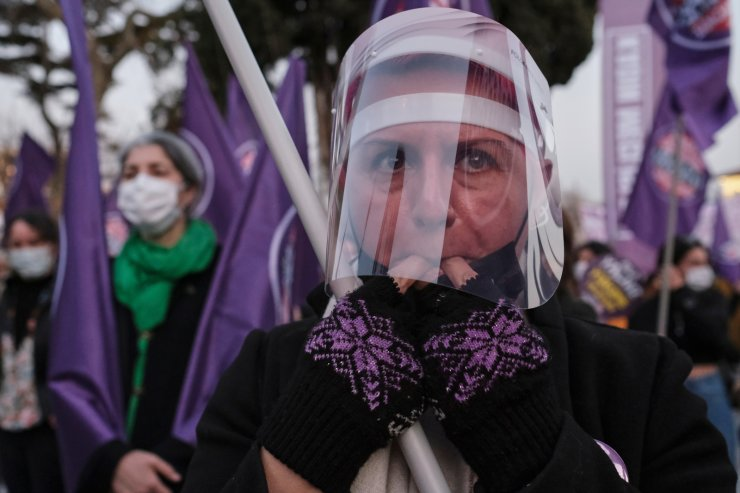 A demonstrator wearing a face shield to prevent the spread of the coronavirus disease (COVID-19), takes part in a protest against femicide and violence against women, in Istanbul, Turkey March 5, 2021. REUTERS