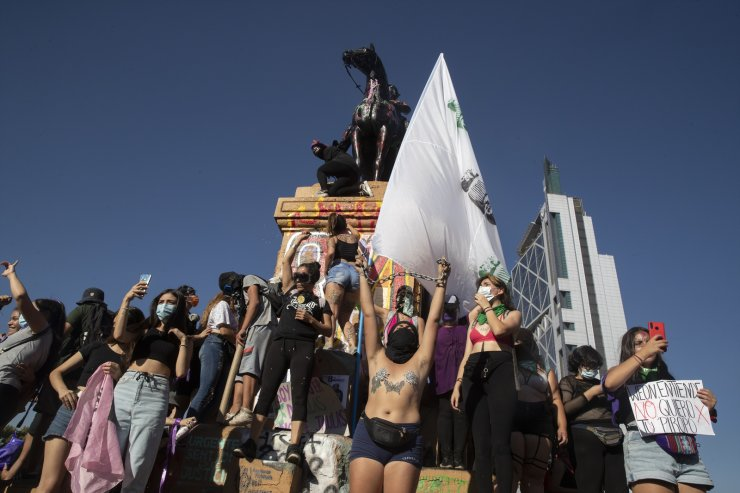 Women demonstrators protest during International Women's Day in Santiago, Chile, Monday, March 8, 2021. AP