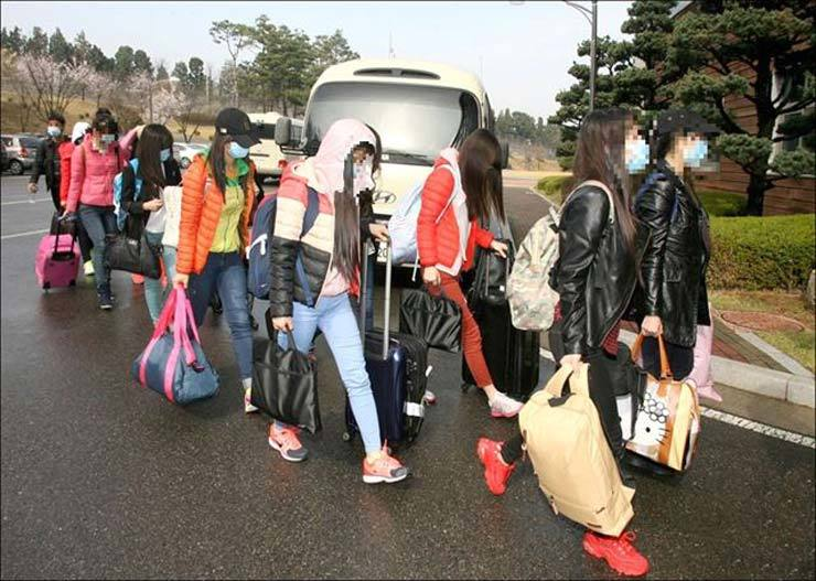 <span>Thirteen North Korean restaurant workers move to their accommodation in South Korea after defecting through Incheon International Airport in this photo taken in April 2016. / Courtesy of Ministry of Unification</span><br /><br />