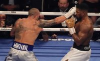 Dominant Usyk ends Joshua's 2nd reign as heavyweight champ
