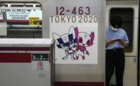 Two Games attendees in hospital as Japan COVID-19 cases surge