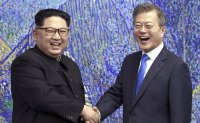 North Korea says restoration of cross-border hotline will play positive role in improving relations