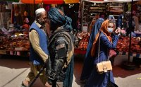 New era for Afghanistan starts with long queues, soaring prices