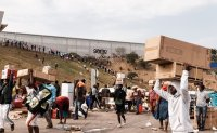 South African looters raid warehouses as riots intensify