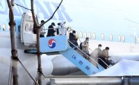Some Korean evacuees have yet to pay for COVID-19 chartered planes