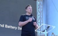 Musk promises dramatic cuts in electronic car costs