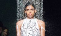 Coats dissolve during fashion show