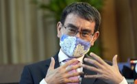 Japan PM Suga to back vaccine minister Kono in leadership race: reports