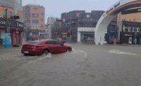 Heavy rains from tropical storm Lupit flood homes, roads on east coast