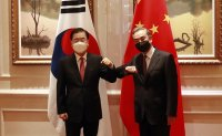 China courting Korea in competition with US