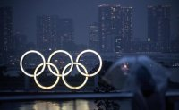 Olympics now ended, Japan races to vaccinate as virus surges