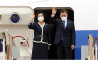 President Moon heads to Britain for G-7 summit