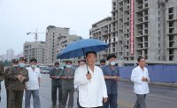 North Korean leader conducts 3rd inspection of riverside apartment construction site