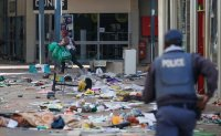 Soldiers deployed after jailing of Zuma ignites violence, looting