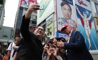 Kim and Trump impersonators wow Osaka crowds ahead of G20 summit