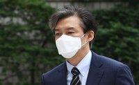 Ex-justice minister files 1-billion-won damage suit against conservative newspaper