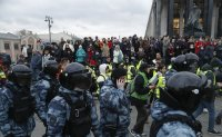 Putin warns the West against crossing 'red line' as thousands protest to back Navalny