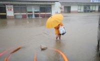 Typhoon Chanthu passes near Jeju, flooding roads, homes, canceling flights