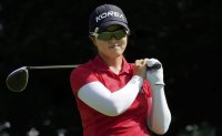 Korean golfer hoping for final round magic with signature red pants