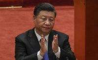 Chinese President Xi Jinping says peaceful reunification with Taiwan is in country's best interests