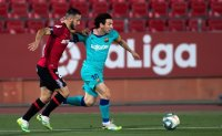 Barca 4-0 win at Mallorca features Messi and pitch invader