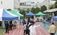Calls rise to strengthen quarantine measures for greater Seoul area