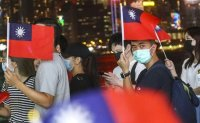 Hongkongers celebrating Taiwan's Double Tenth public holiday risk secession charge, security chief warns