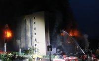 Firefighter stranded inside fire-hit building