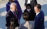 Moon meets Biden, Suga at G-7 summit