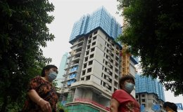 At unfinished Evergrande apartments in central China, buyers seek answers
