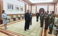North Korean leader holds photo session with families of army after attending performance