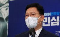 Ruling party chief apologizes over scandal involving former justice minister