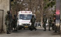 Ecuador says clashes between prison gangs leave more than 100 dead